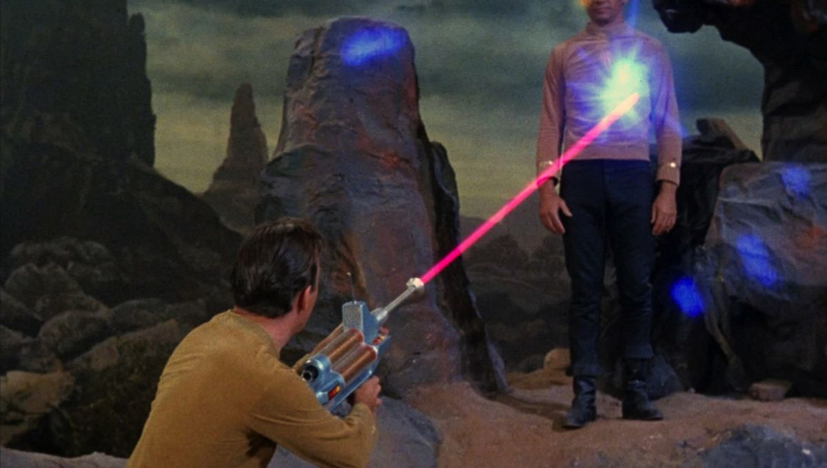 Kirk_fires_a_phaser_rifle_at_Mitchell.jpg