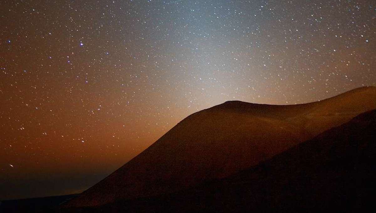 Zodiacal light, sunlight reflected off of tiny dust particles that orbit the Sun between Earth and the asteroid belt. Credit: Rogelio Bernal Andreo