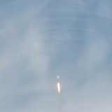 rocket taking off with visible sound waves