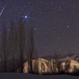A bright Geminid streaks past Orion and the bright star Sirius in the 2009 shower. Credit: Babak Tafreshi