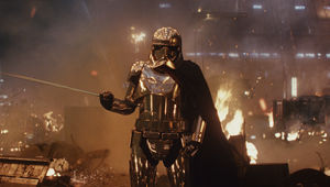 Captain Phasma in standing by wreckage in the Last Jedi