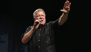 William Shatner posing with microphone