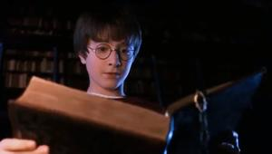 Harry Potter in the Restricted section of the Hogwarts Library