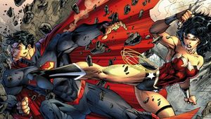 Superman kicked by Wonder Woman