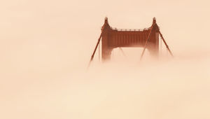 """The Golden Gate Bridge almost lost in fog flowing in from the Pacific Ocean. Taken from the video """"Adrift""""."""