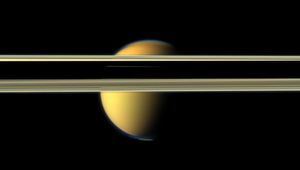 Titan tries to hide behind Saturn's rings in this image from 2012. Note the visible bluish haze layer in Titan's upper atmosphere. Credit: NASA/JPL-Caltech/SSI