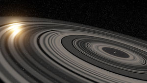 Art depicting a newly formed exoplanet, still surrounded by the disk of gas and dust from which it formed, sculpted into a vast set of Saturn-like rings. Credit: Ron Miller