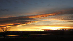 A wide view of a Colorado sunset shows fluctus clouds, crepuscular rays, and magnificent colors. Credit: Phil Plait