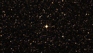 Gleise 710 (center), an orange dwarf, will one day become the closest star to our Sun. Credit: SIMBAD / DSS