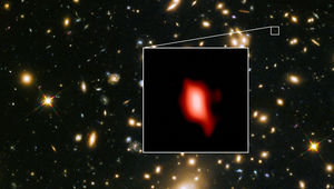 The galaxy cluster MACSJ1149.5+223 lies in the foreground and magnifies the image of the much more distant JD1, a galaxy 13.3 billion light years away. Inset is the observation of oxygen from the galaxy.