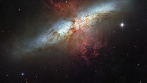 The starburst galaxy M82, with red tendrils of gas and dust being expelled by stars in its center. Credit: NASA, ESA and the Hubble Heritage Team (STScI/AURA). Acknowledgment: J. Gallagher (University of Wisconsin), M. Mountain (STScI) and P. Puxley (NSF)