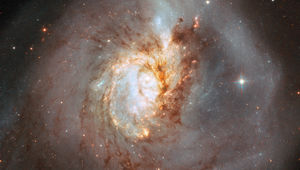 A closer look at the center of NGC 3256 reveals the chaos there, struggling to recover order. Dark dust clouds and bright stars may yet retain their overall spiral distribution.  Credit: ESA/Hubble, NASA