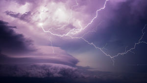 """Lighting erupts from a spring storm. From the video, """"Pursuit""""."""