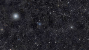 Ursa Minor —the Little Dipper —is gorgeous in this deep mosaic that shows thousands of stars, faint wisps of dust, and a brief interplanetary visitor. Credit: Rogelio Bernal Andreo