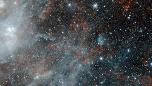 The supernova remnant HBH 3 can be seen as wispy red tendrils in this Spitzer Space Telescope image. The other objects are star forming regions. Credit: NASA/JPL-Caltech/IPAC
