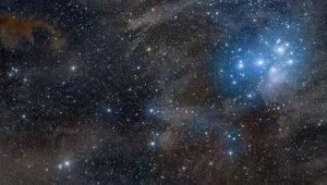 The Pleiades and galactic cirrus. Credit: Rogelio Bernal Andreo