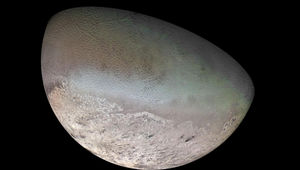 A mosaic of Neptune's moon Triton created from Voyager 2 images during a flyby in 1989.  Note the black streaks near the bottom; evidence of geyser-like eruptions and wind. Credit: NASA/JPL/USGS