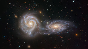 NGC 5426 (right) and NGC 5427 (left), together known as Arp 271, are close enough to each other to be interacting. Credit: ESO/Juan Carlos Muñoz