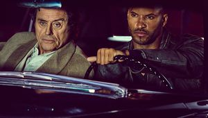 636244380941262929-Ian-McShane-Mr-Wednesday-Ricky-Whittle-Shadow-Moon-American-Gods.jpg
