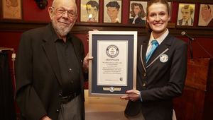 Al_with_Guinness_World_Records_adjudicator_Kellie_Ferrick_after_Al_received_the_Guinness_World_Record_for_having_the_longest_career_as_a_comics_artist_0.jpg