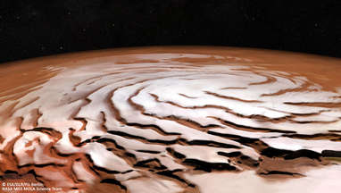 An oblique view of the Martian north polar cap using images from Mars Express combined with laser altimeter data to artificially change the perspective. The spiral trough pattern is obvious. Credit: ESA/DLR/FU Berlin, NASA MGS MOLA Science Team