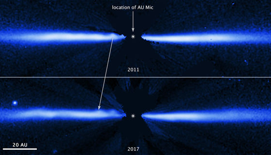 Hubble/STIS images of AU Mic taken a few years apart show the motion of a blob moving outward from the star. Credit: NASA, ESA, J. Wisniewski (University of Oklahoma), C. Grady (Eureka Scientific), and G. Schneider (Steward Observatory)