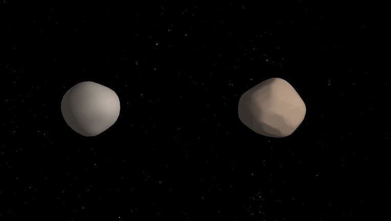 Artwork depicting what the binary asteroid 2017 YE5 might look like. Credit: NASA/JPL-Caltech