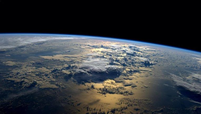 Earth as seen from the International Space Station, just after sunrise.