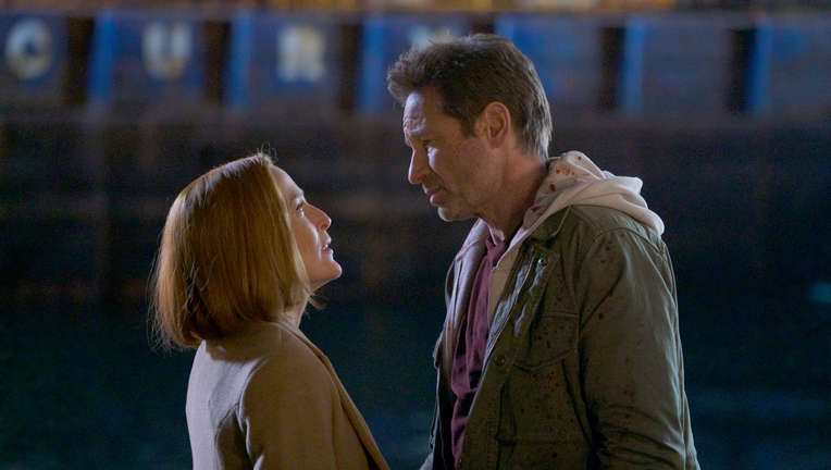 The X-Files episode 1110 - Mulder and Scully look at each other intently