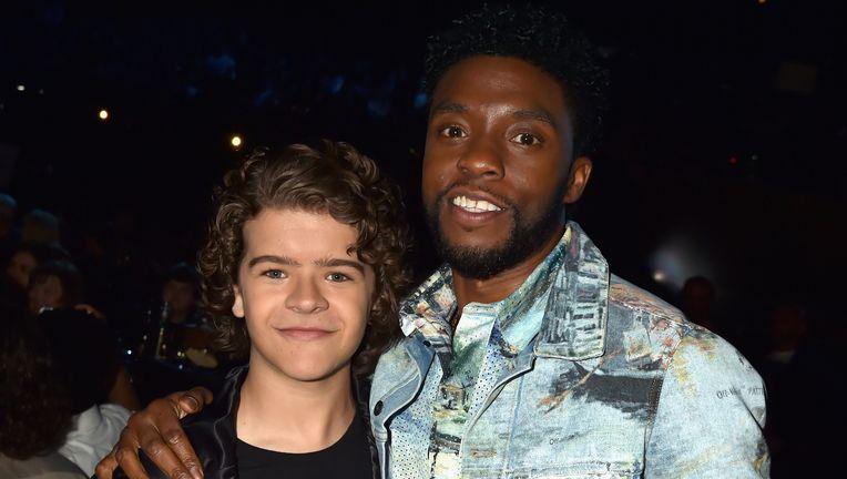 Actors Gaten Matarazzo and Chadwick Boseman attend the 2018 MTV Movie And TV Awards
