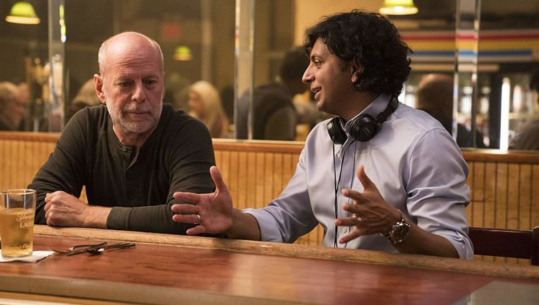 Bruce Willis and M Night Shyamalan on the set of Glass