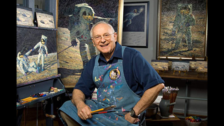 Al Bean posing with some of his artwork. Credit: Smithsonian Institution / Carolyn Russo