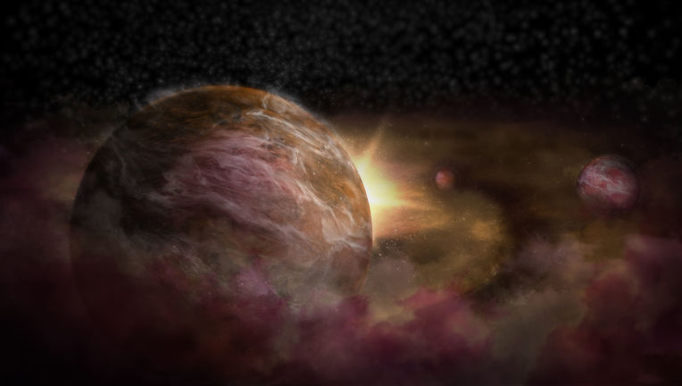 Artist concept of three still-forming planets orbiting the young star HD 163296.  Credit: NRAO/AUI/NSF; S. Dagnello