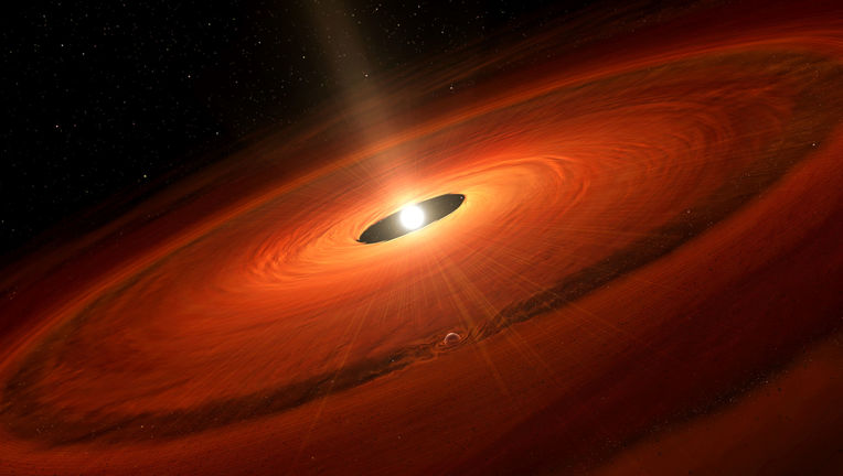 Artwork of a planet forming in a young star's disk. Credit: NAOJ
