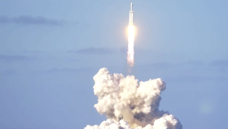 The Falcon Heavy lifts off, on its way to orbit and then Mars. Credit: SpaceX