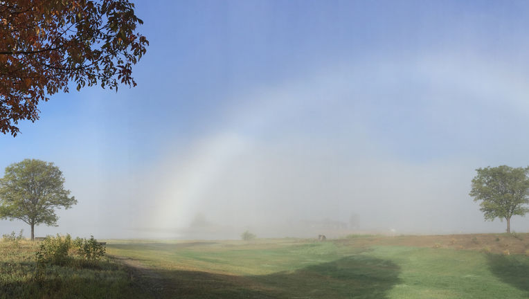 A fogbow created by the tiny droplets of water in a fog with strong sunlight behind the observer. Credit: Phil Plait