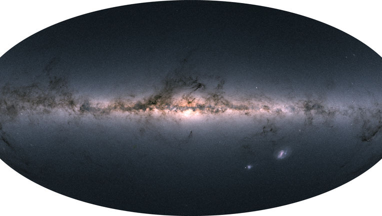 The entire sky — 1.7 billion stars' worth — mapped by Gaia and displayed using color information also obtained by the satellite. You can see we live in a flat galaxy with a large central bulge, festooned with dark filaments of dust. Credit: Gaia/DPAC/ESA