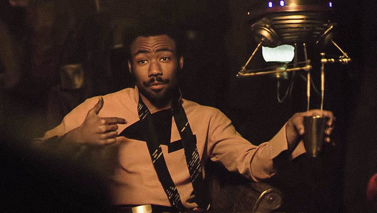 Solo: A Star Wars Story- Donald Glover as Lando (droid refilling drink)