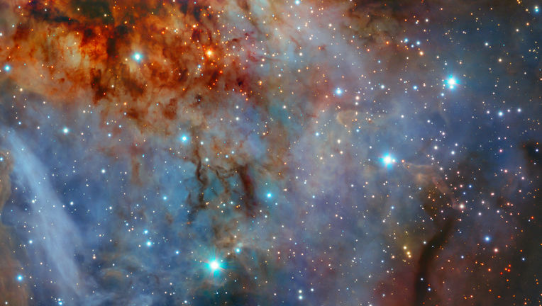 The RCW 38 stellar cluster, embedded in thick gas and dust, imaged by the HAWK-I camera on the Very Large Telescope. Credit: ESO/K. Muzic
