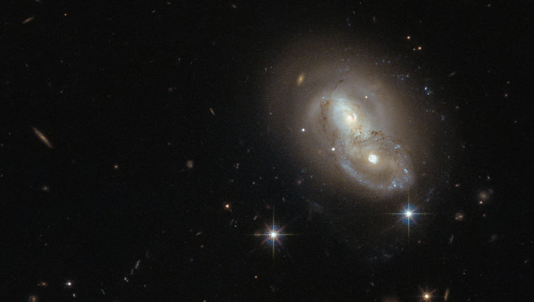 The galaxies collectively known as IRAS 06076-2139 are weakly interacting, but they've had an exciting past. Credit: ESA/Hubble & NASA