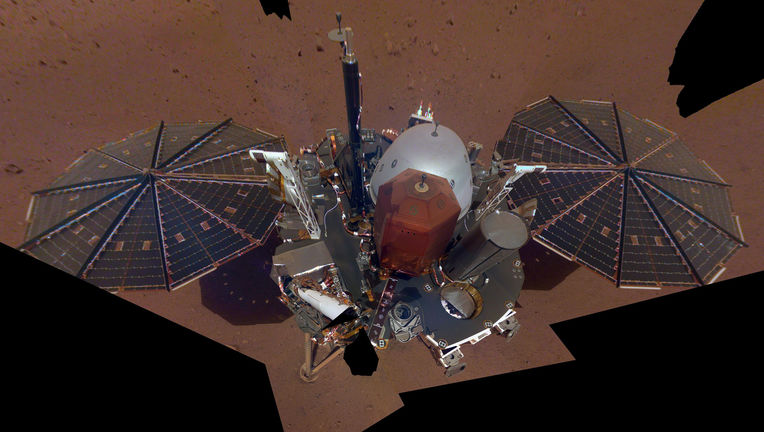 "A ""selfie"" of the Mars InSight lander, using 11 images taken by a camera mounted on a mobile robotic arm. Credit: NASA/JPL-Caltech"