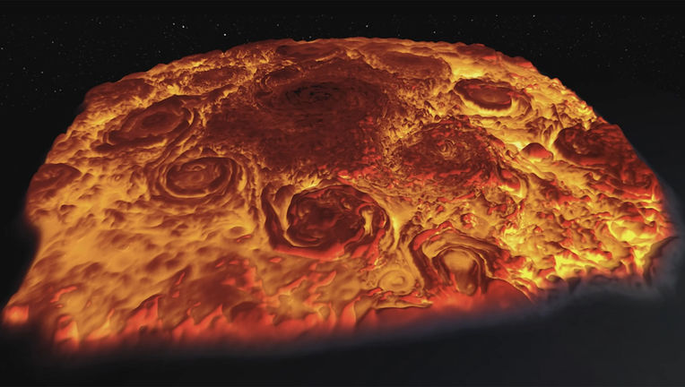 Jupiter's north pole looks like a thick cheesy pizza in this 3D rendering of the clouds using a thermal infrared mapper on the Juno spacecraft (deeper air is warmer and glows more brightly than cooler air higher up).