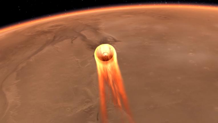 Minutes before reaching the surface, the Mars InSight lander must pass through the Martian atmosphere at high speed, ramming the air and heating up like a meteor. Credit: NASA/JPL-Caltech