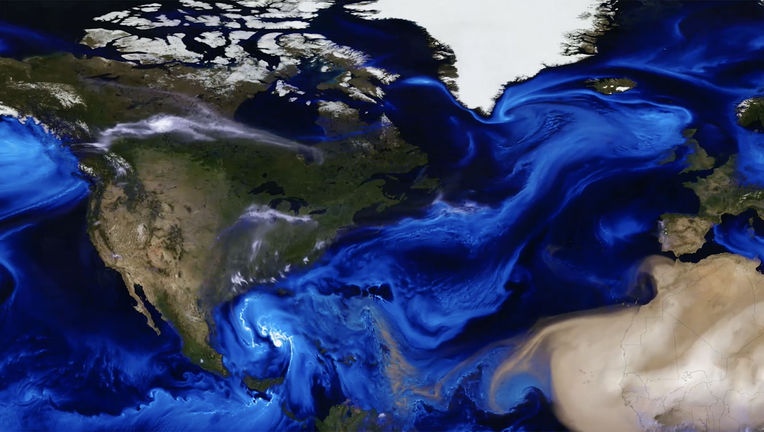 A satellite/computer map showing the movement of aerosols, particles suspended in the air, over part of the northern hemisphere. Credit: NASA's Goddard Space Flight Center