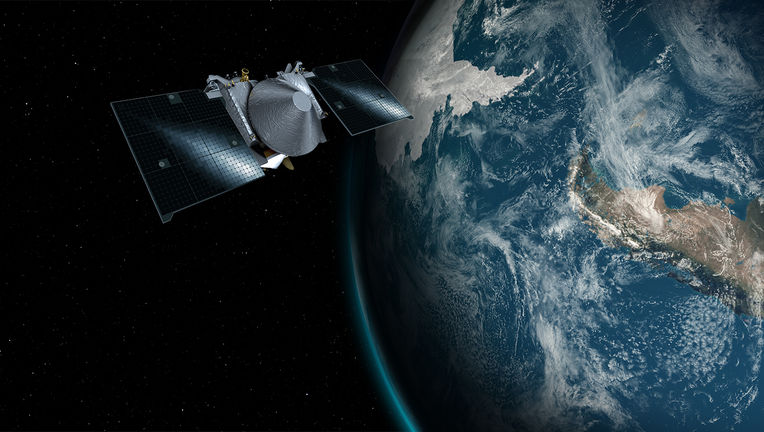 Artwork showing OSIRIS-REx flying past Earth above Antarctica and South America. Credit: NASA Goddard Space Flight Center/University of Arizona