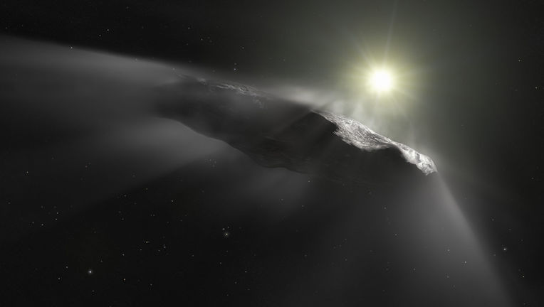 'Oumuamua, the first object ever seen passing through our solar system from interstellar space, is shown in this artwork to be faintly outgassing as the Sun warms its ice. Credit: ESA/Hubble, NASA, ESO, M. Kornmesser