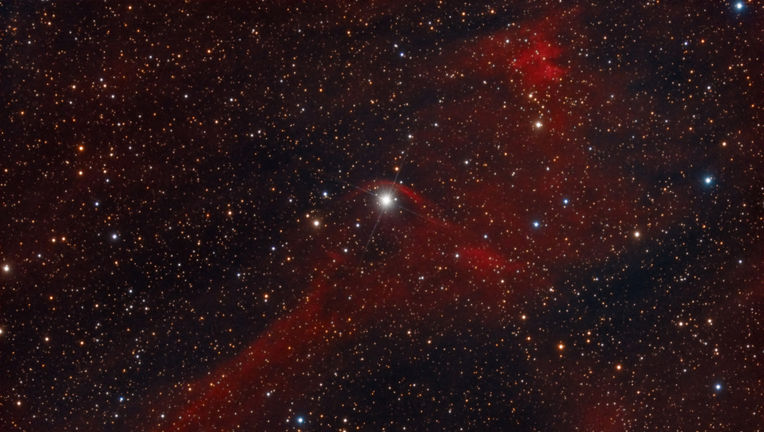 An arc of gas betrays the motion of Vela X-1 through the galaxy; the star is plowing through gas and creating a bow shock. Credit: Rolf Olsen