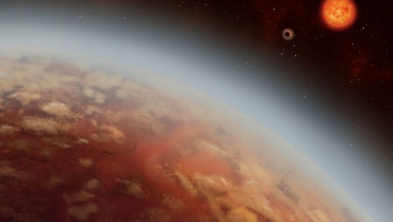 Two super-Earths orbit a red dwarf star in this artwork. As system like this may be extremely common in the Universe. Credit: Alex Boersma