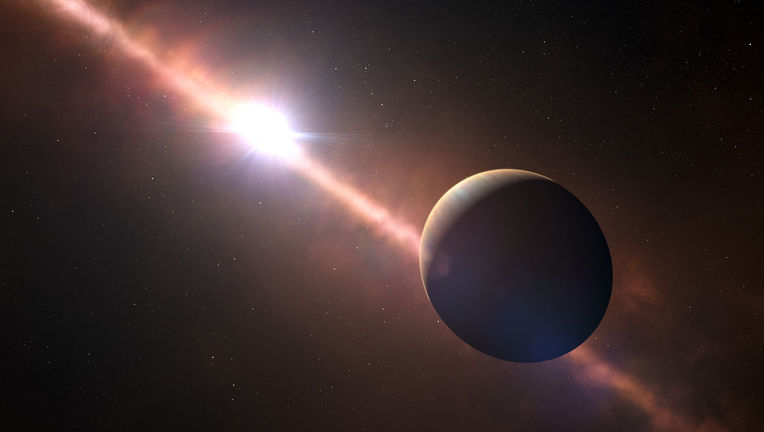 Artwork depicting the exoplanet Beta Pictoris b, showing the planet-forming debris disk around the star. The planet is flattened due to its rapid rotation. Credit: ESO L. Calçada/N. Risinger (skysurvey.org)