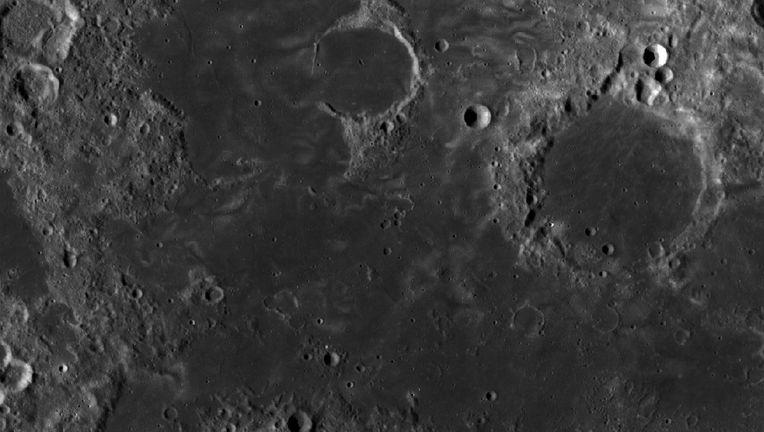 "Lunar swirls in Mare Marginis (literally, ""Margin or Border Sea"", since it's on the edge of the Moon's near side). Credit: NASA/GSFC/Arizona State University"